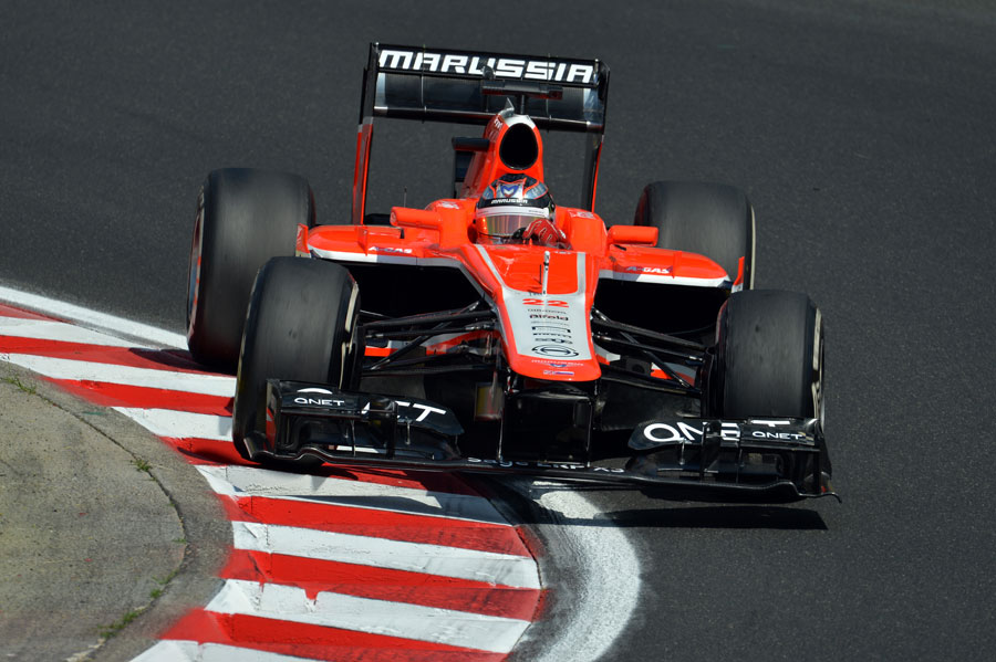 Jules Bianchi mounts the kerb in the Marussia