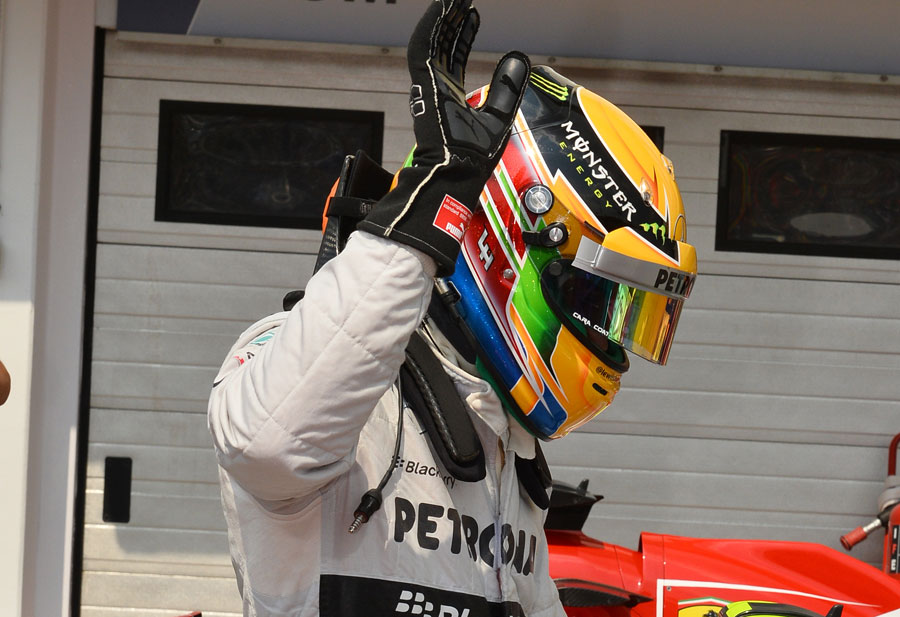 Lewis Hamilton waves to the crowd after taking pole
