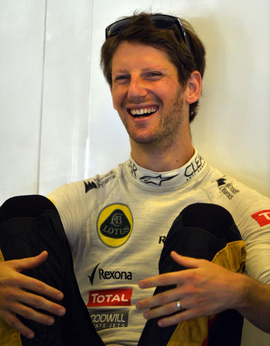 Romain Grosjean enjoys a joke in the Lotus garage