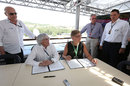 Bernie Ecclestone signs a contract extension for the Hungarian Grand Prix