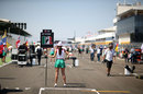 A grid girl waits for the arrival of Esteban Gutierrez on the grid