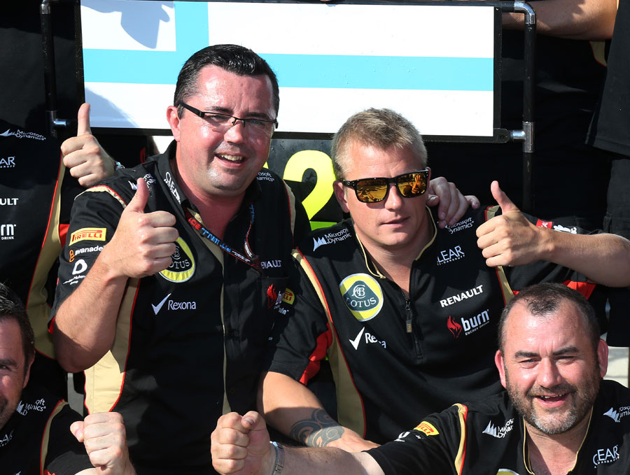 Kimi Raikkonen and Eric Boullier celebrate second place