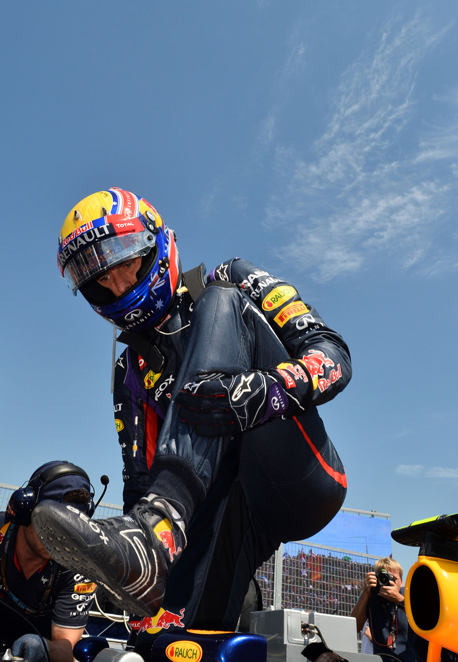 Mark Webber steps out of his car on the grid
