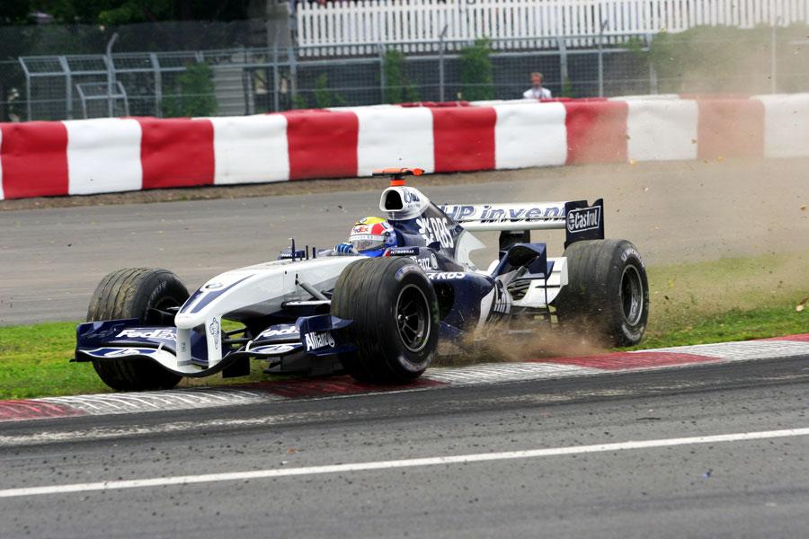 Mark Webber runs wide