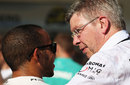 Ross Brawn has a quiet word with Lewis Hamilton after the race