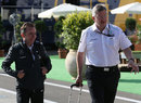 Paddy Lowe and Ross Brawn walk through the paddock