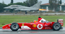 Michael Schumacher takes on a Eurofighter Typhoon in his Ferrari F2003