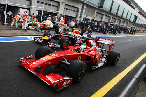 Massa and Vettel jockey for position in the pit lane