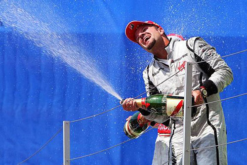 Barrichello on the podium after his win at Valencia