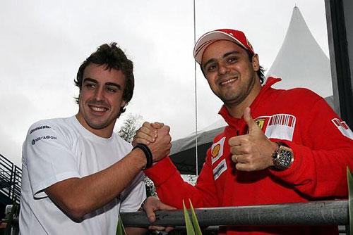 New Ferrari team-mates Massa and Alonso pose for a photo