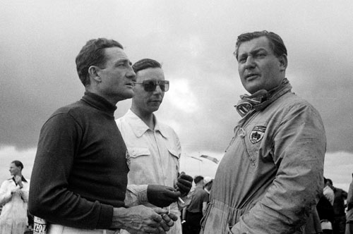 Duncan Hamilton stands with George Abecassis and Briggs Cunningham