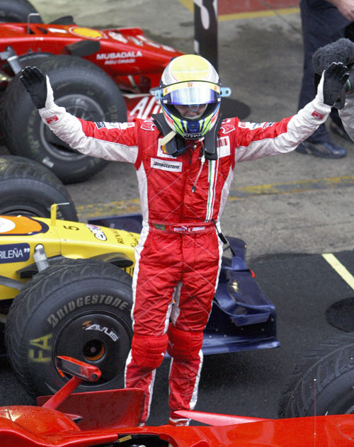 Felipe Massa celebrates after winning the Brazilian Grand Prix
