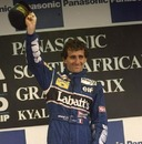 Alain Prost of France celebrates victory in the South African Grand Prix