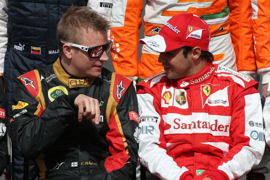 Kimi Raikkonen chats to Felipe Massa during the traditional pre-season group shot