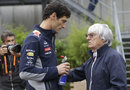 Mark Webber chats to Bernie Ecclestone in the paddock