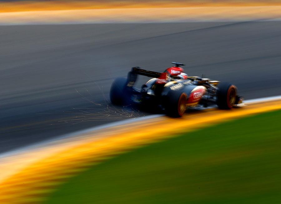 Sparks fly from Kimi Raikkonen's Lotus