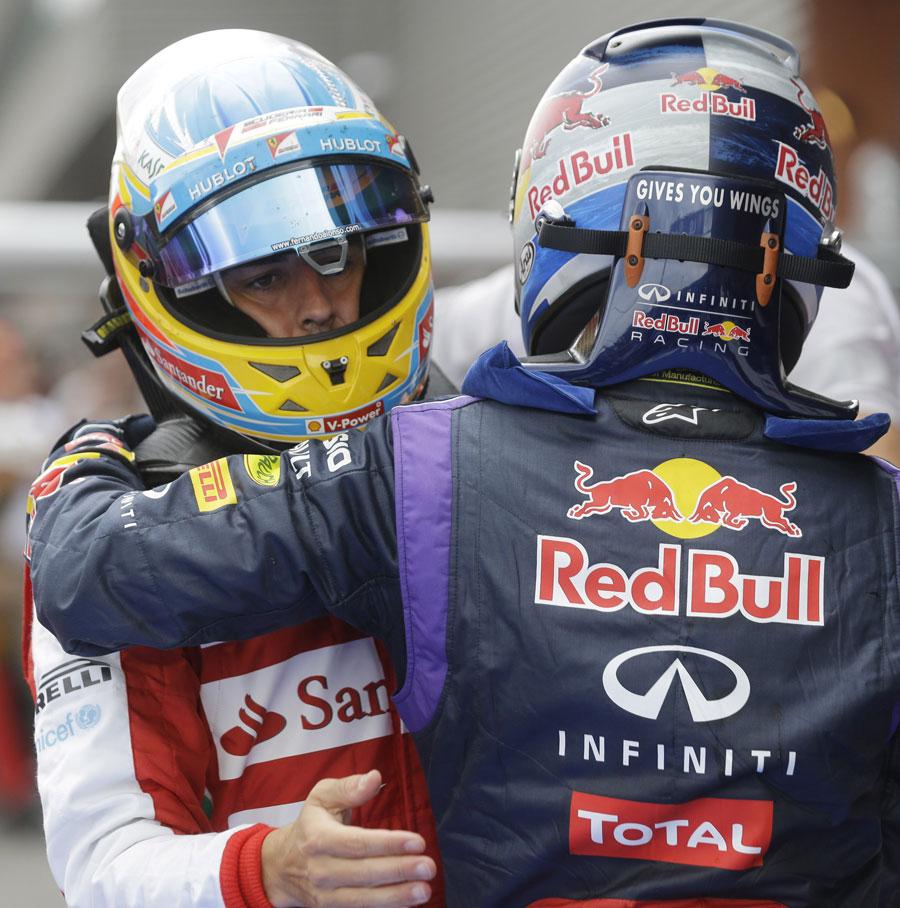 Fernando Alonso congratulates Sebastian Vettel in parc ferme