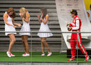 Fernando Alonso sprays some grid girls on the podium