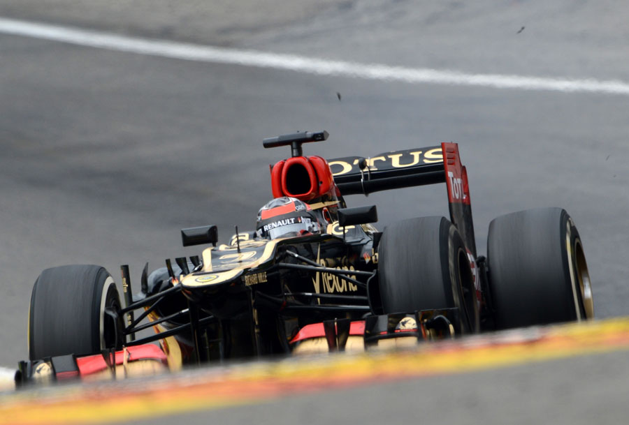 Kimi Raikkonen ascends up Eau Rouge