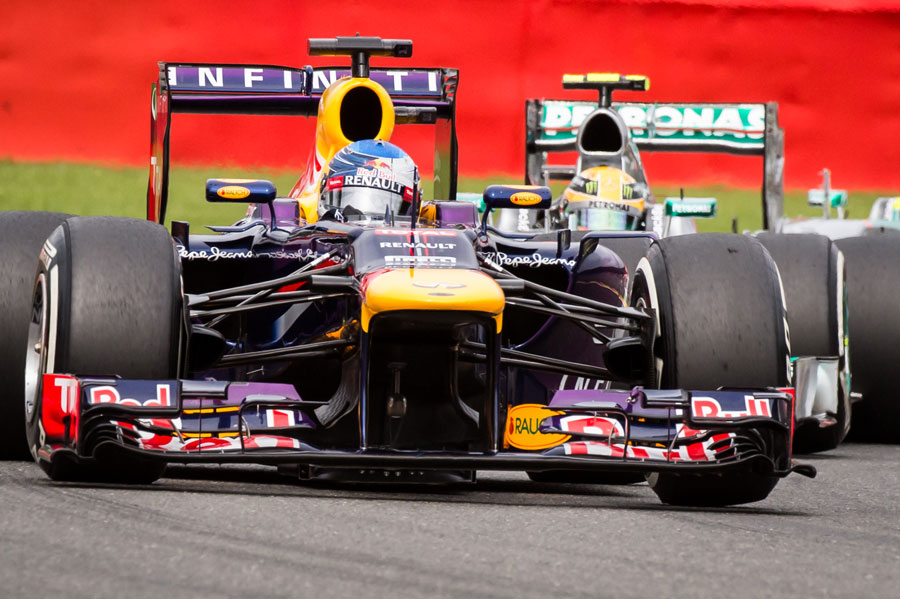 Sebastian Vettel leads Lewis Hamilton early in the race