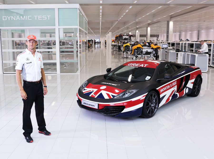 Jenson Button poses with a specially liveried McLaren MP4-12C to promote British innovation