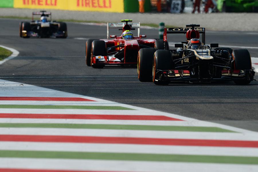 Kimi Raikkonen leads Felipe Massa back in to the pits