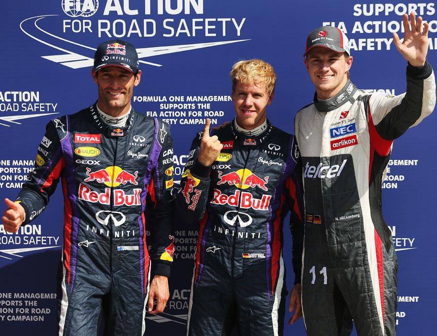 Sebastian Vettel celebrates pole with Mark Webber and Nico Hulkenberg