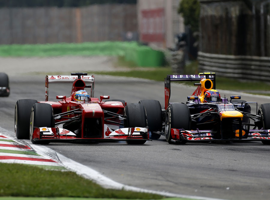 Fernando Alonso makes a move around the outside of Mark Webber at the second chicane