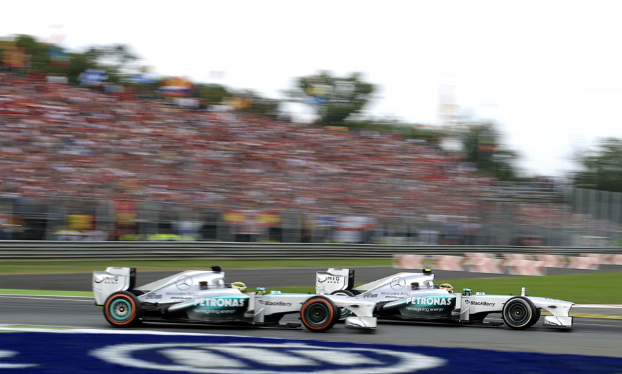 Lewis Hamilton passes team-mate Nico Rosberg at the first chicane