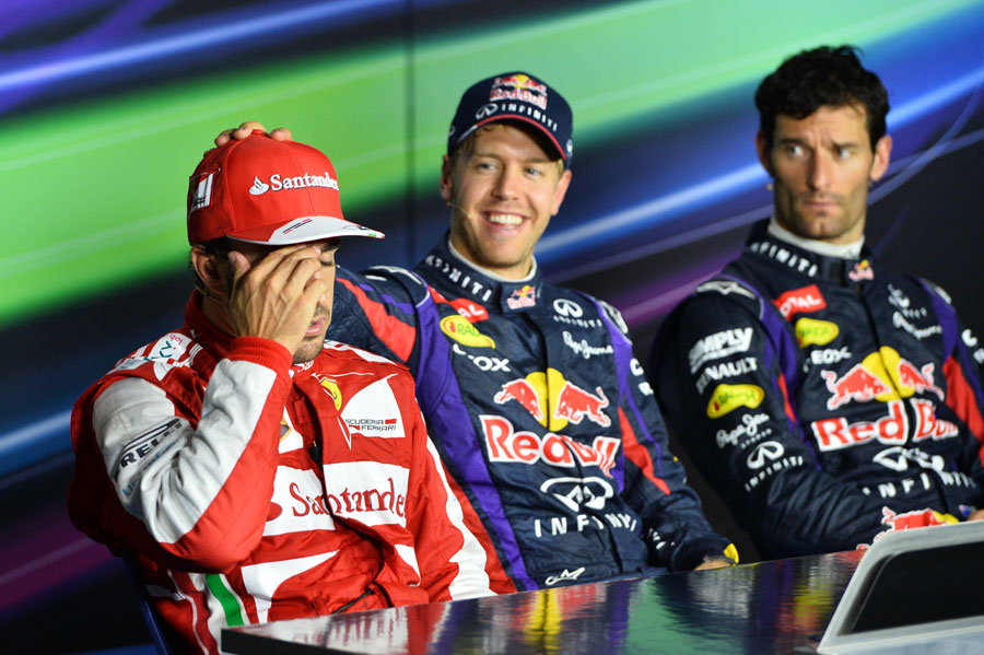 Sebastian Vettel jokes with Fernando Alonso in the post-race press conference
