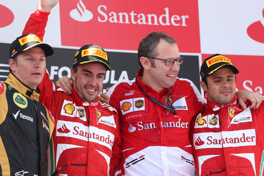 Kimi Raikkonen, Fernando Alonso, Stefano Domenicali and Felipe Massa celebrate on the podium
