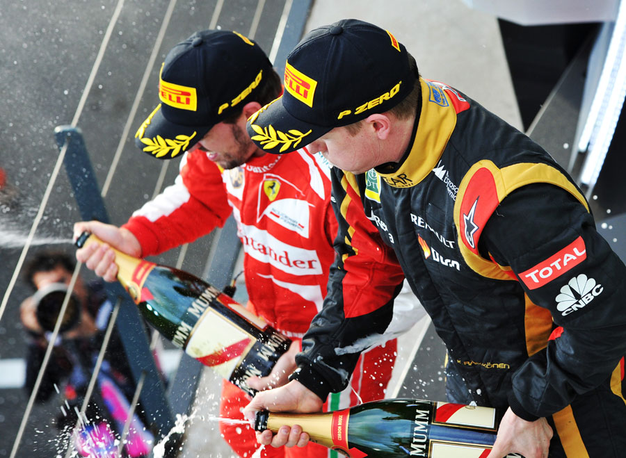 Kimi Raikkonen and Fernando Alonso celebrate on the podium