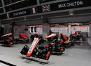 The Marussia garage under floodlights