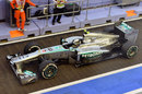 Lewis Hamilton leaves the pits in his Mercedes