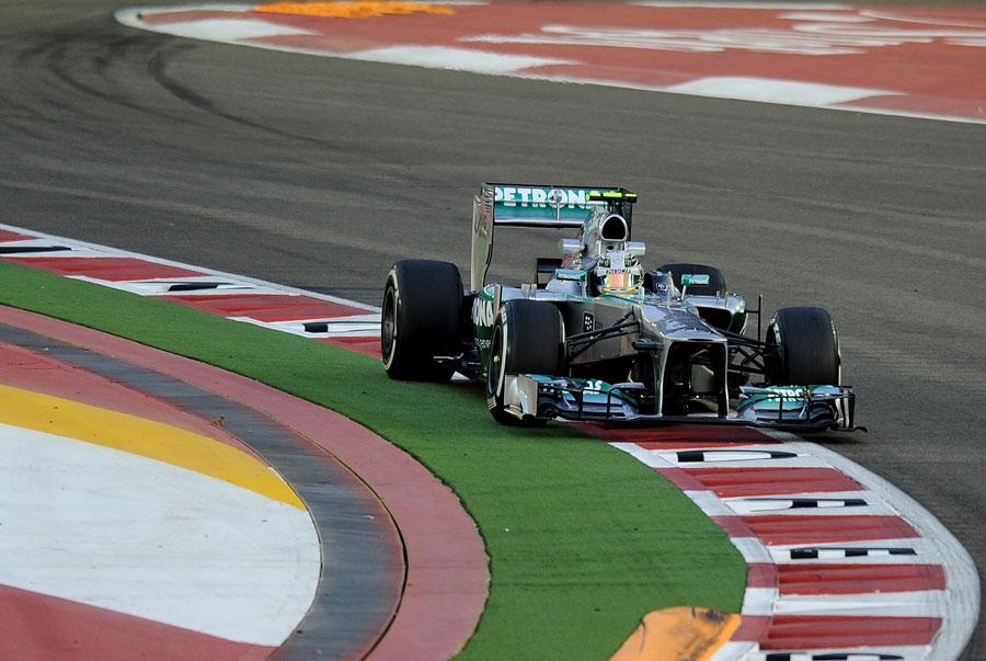 Lewis Hamilton steers his Mercedes into the corner