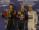 Sebastian Vettel celebrates pole position ahead of Nico Rosberg and Romain Grosjean