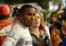 Lewis Hamilton talks to the media
