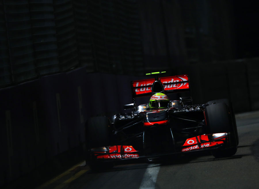 Sergio Perez drives through the shadows