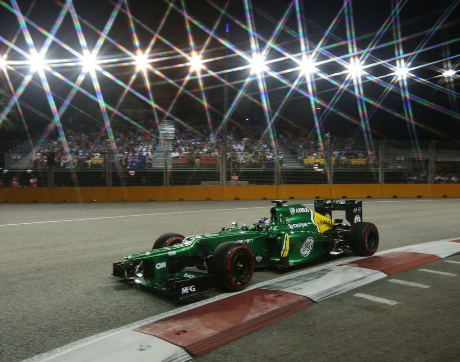 Charles Pic guides his car under the spotlights