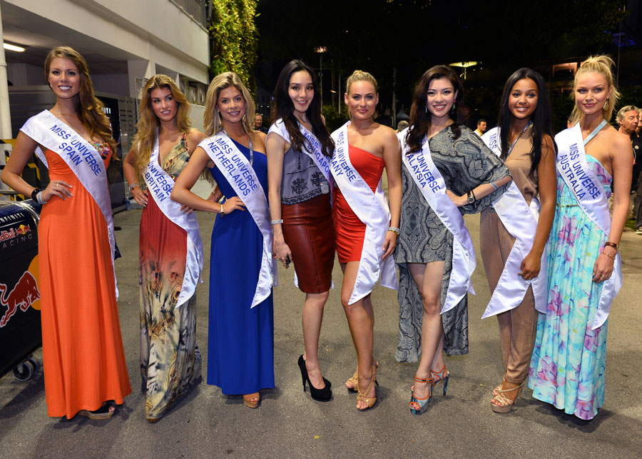 Miss Universe contestants in the paddock