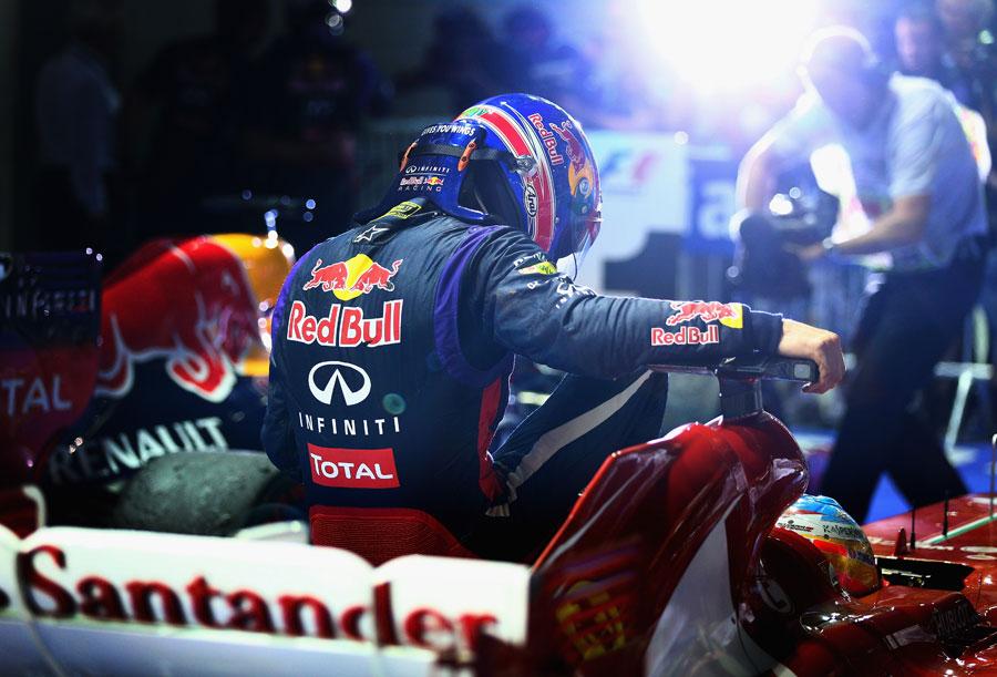 Mark Webber returns to parc ferme on Fernando Alonso's Ferrari