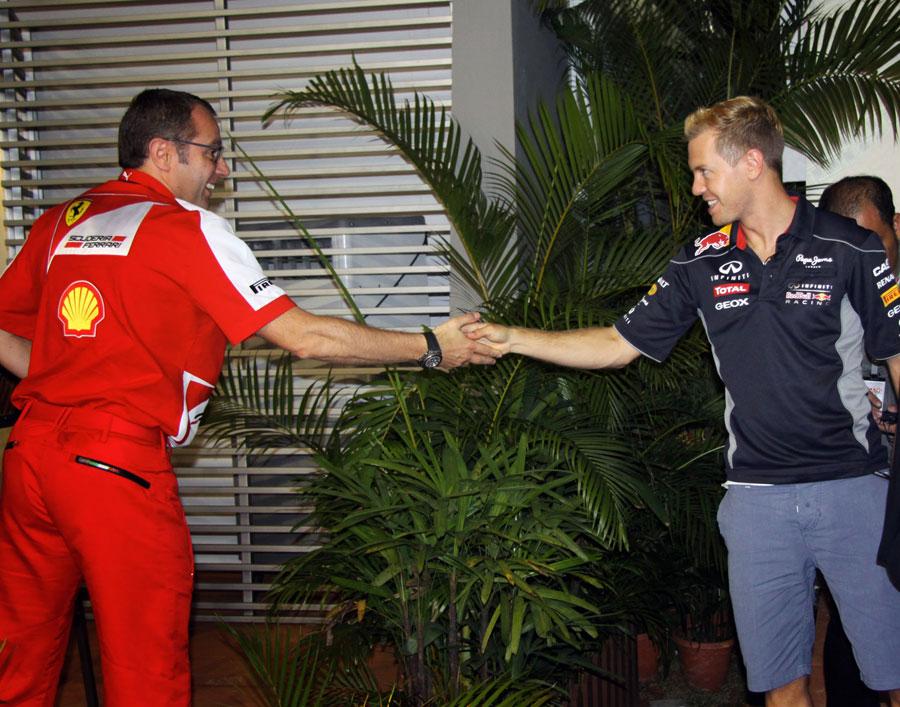 Ferrari boss Stefano Domenicali congratulates Sebastian Vettel on victory