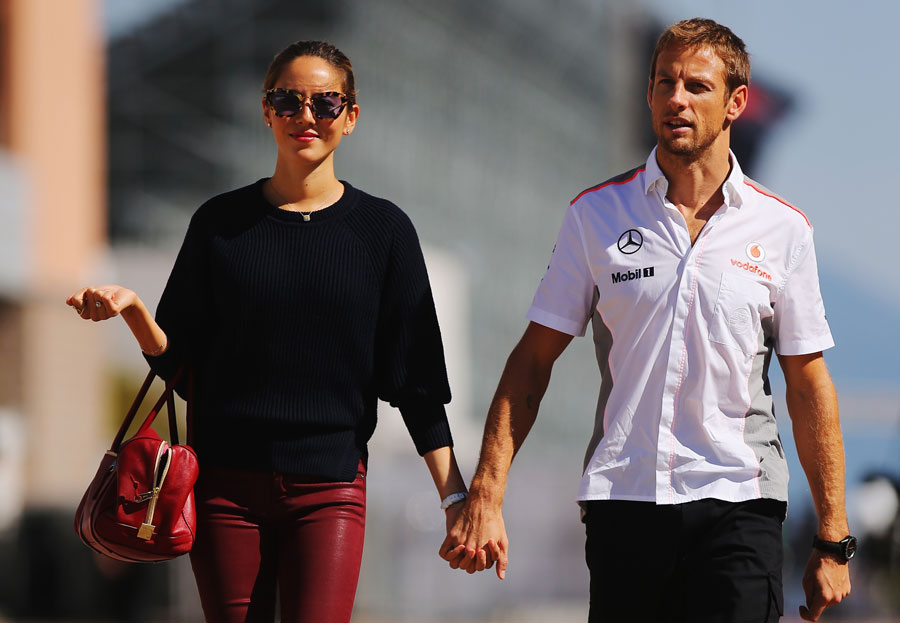 Jenson Button arrives in the paddock with his girlfriend Jessica Michibata