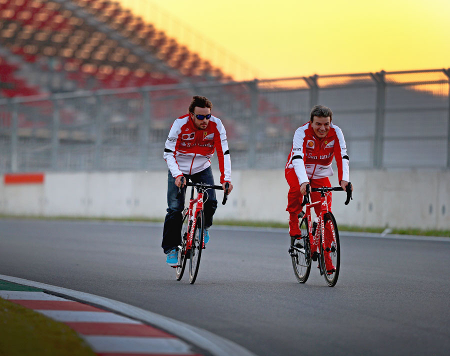 Fernando Alonso cycles the circuit on Thursday evening