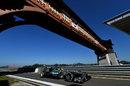 Lewis Hamilton returns to the pit lane