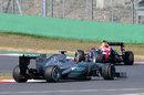 Mark Webber leads Nico Rosberg on track