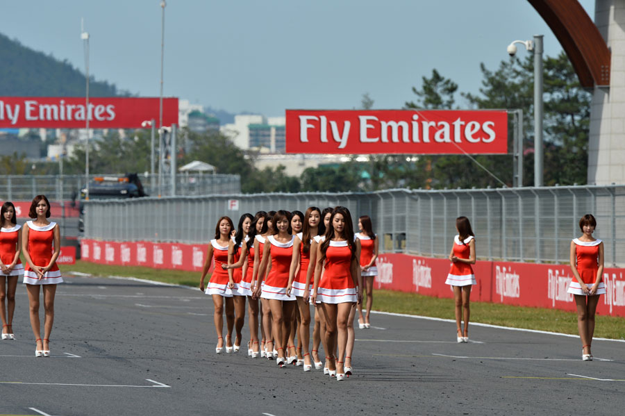 Grid girls practice ahead of the race