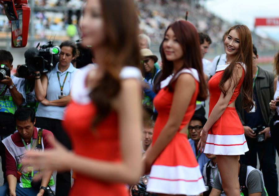 Grid girls pose for the media