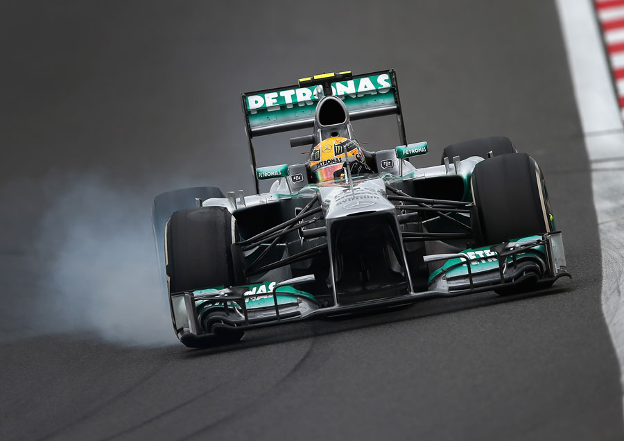 Lewis Hamilton locks up his front-right tyre