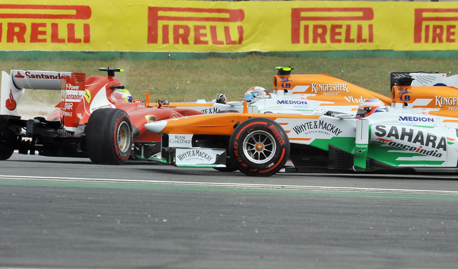 Paul di Resta and Adrian Sutil try to avoid a spinning Felipe Massa